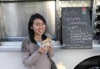berkeley-north-gourmet-ghetto-off-the-grid-lush-gelato-epicurius-garden-1511-shattuck-woman-smiling-eating-2